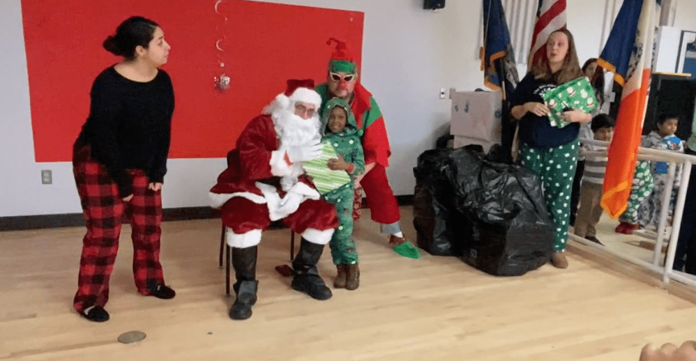 Santa Visits Schoolchildren… with help from the Machinists Union!