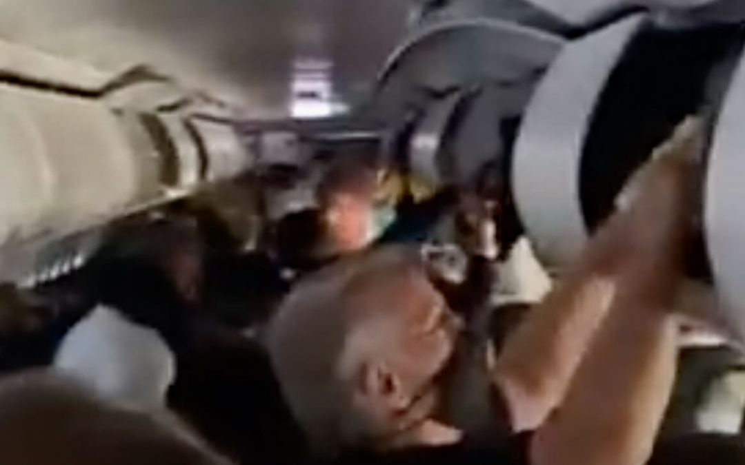 WATCH: Passengers Delay Evacuation to Collect Personal Items From Overhead Bins